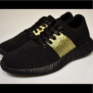 Brand New Black Flyknit Sneakers With Gold Detail.